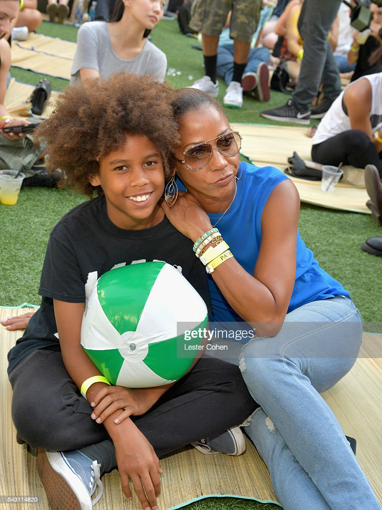 Actress Holly Robinson Peete (R) and guest attend EpicFest 2016 hosted by L.A. Reid and Epic Records at Sony Studios on June 25, 2016 in Los Angeles, California.