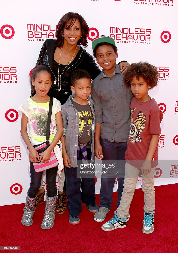 "Actress <a gi-track='captionPersonalityLinkClicked' href=/galleries/search?phrase=Holly+Robinson+Peete&family=editorial&specificpeople=213716 ng-click='$event.stopPropagation()'>Holly Robinson Peete</a> and guests with Mindless Behavior at Universal CityWalk for the premiere of ""All Around The World"" & a performance presented by Target at Universal CityWalk on March 10, 2013 in Universal City, California."
