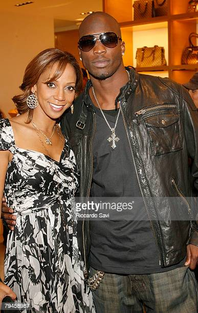 Actress Holly Robinson Peete and NFL wide receiver Chad Johnson attend the private brunch at the Louis Vuitton charity to benefit HollyRod held at...