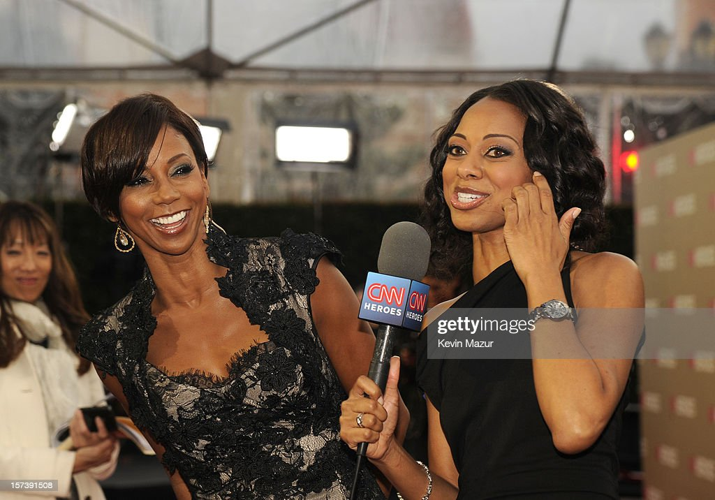 Actress Holly Robinson Peete (L) and red carpet hostess Nischelle Turner attend the CNN Heroes: An All Star Tribute at The Shrine Auditorium on December 2, 2012 in Los Angeles, California. 23046_004_KM_0330.JPG