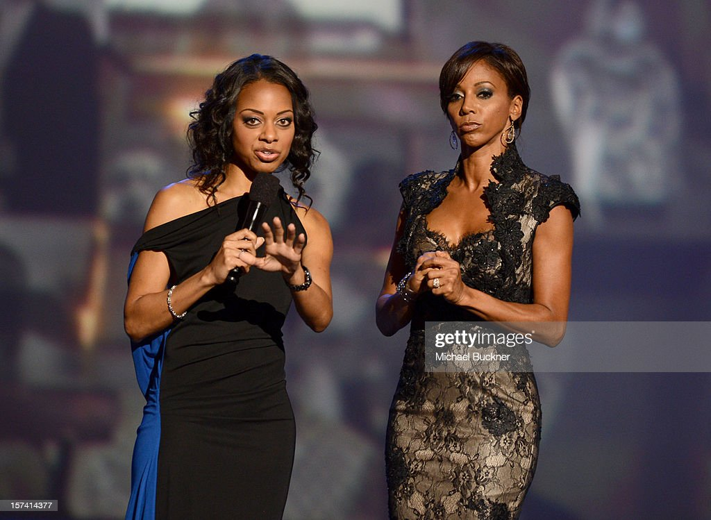 Actress <a gi-track='captionPersonalityLinkClicked' href=/galleries/search?phrase=Holly+Robinson+Peete&family=editorial&specificpeople=213716 ng-click='$event.stopPropagation()'>Holly Robinson Peete</a> (R) and show host Nischelle Turner speak onstage during the CNN Heroes: An All Star Tribute at The Shrine Auditorium on December 2, 2012 in Los Angeles, California. 23046_006_MB_0694.JPG