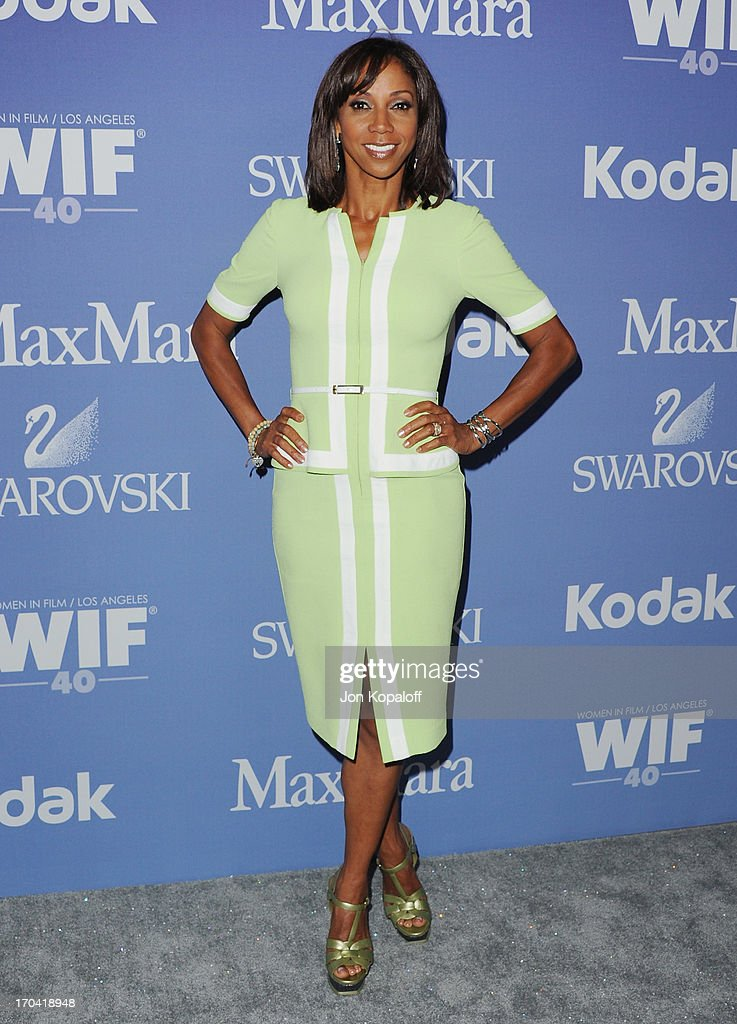 Actress Holly Robinson Peete arrives at the 2013 Women In Film's Crystal Lucy Awards at The Beverly Hilton Hotel on June 12 2013 in Beverly Hills...