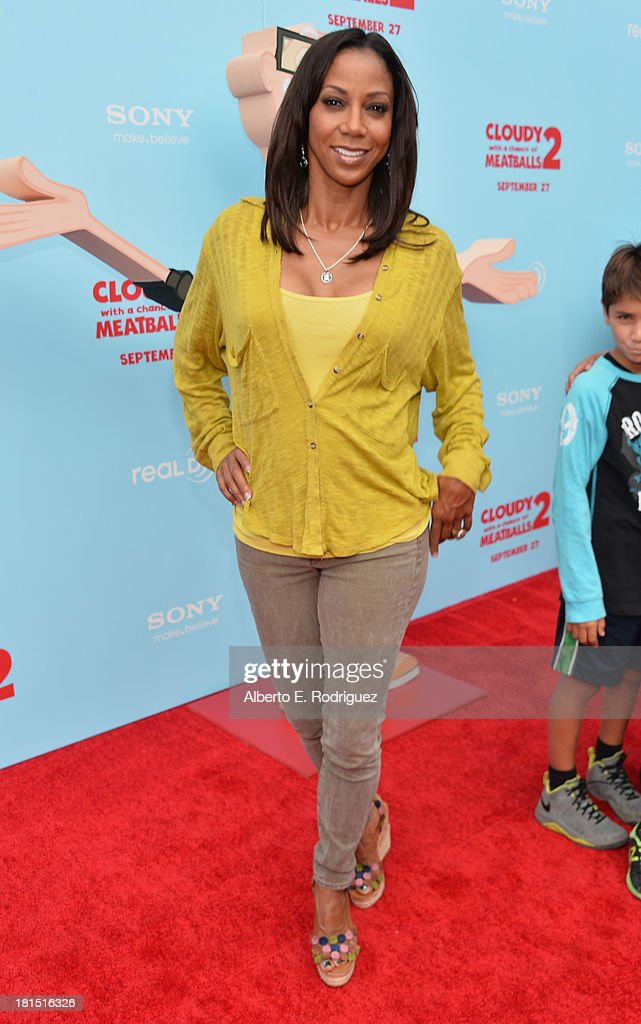 Actress Holly Robinson Peete arrives to the premiere of Columbia Pictures and Sony Pictures Animation's 'Cloudy With A Chance of Meatballs 2' at the Regency Village Theatre on September 21, 2013 in Westwood, California.