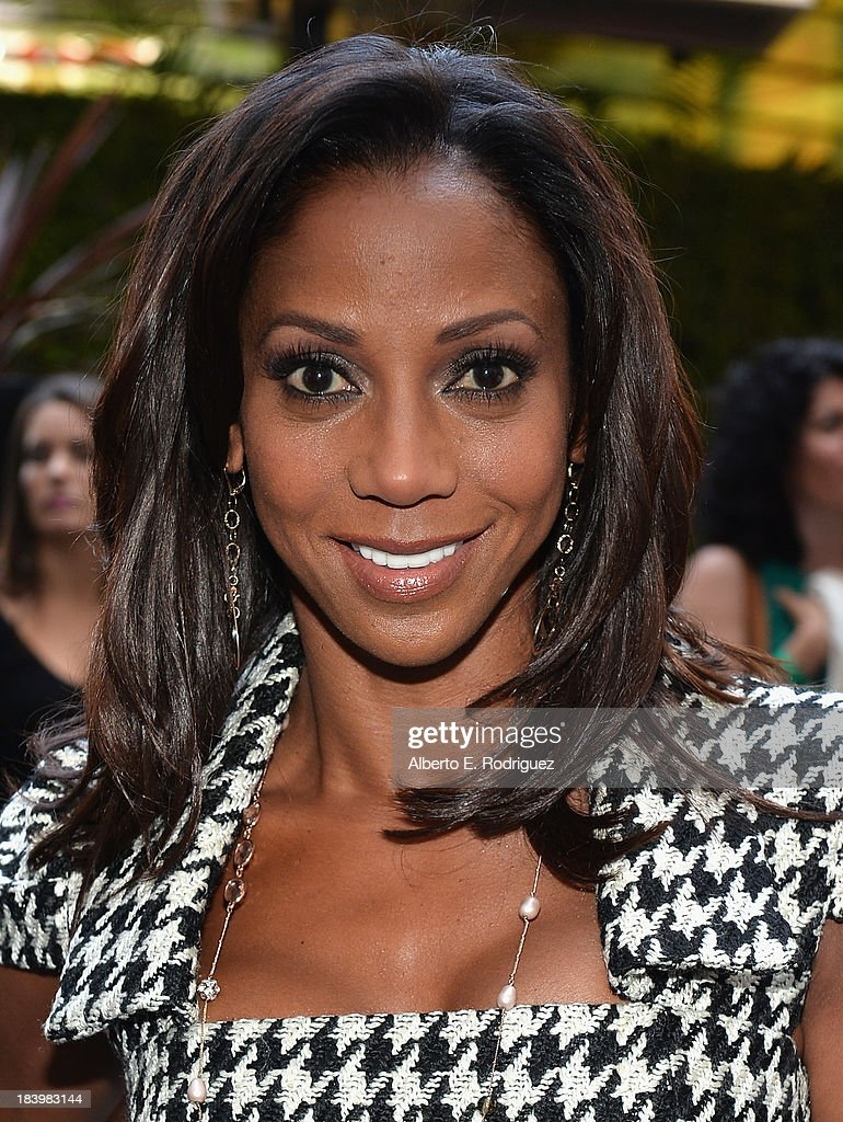 Actress <a gi-track='captionPersonalityLinkClicked' href=/galleries/search?phrase=Holly+Robinson+Peete&family=editorial&specificpeople=213716 ng-click='$event.stopPropagation()'>Holly Robinson Peete</a> attends a ceremony honoring Kenny 'Babyface' Edmonds with the 2508th Star on the Hollywood Walk of Fame on October 10, 2013 in Hollywood, California.
