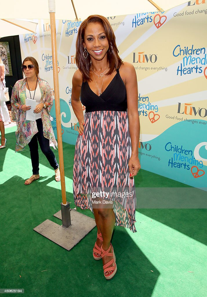 Actress <a gi-track='captionPersonalityLinkClicked' href=/galleries/search?phrase=Holly+Robinson+Peete&family=editorial&specificpeople=213716 ng-click='$event.stopPropagation()'>Holly Robinson Peete</a> attends the Children Mending Hearts 6th Annual Fundraiser 'Empathy Rocks: A Spring Into Summer Bash' at a private residence on June 14, 2014 in Beverly Hills, California.