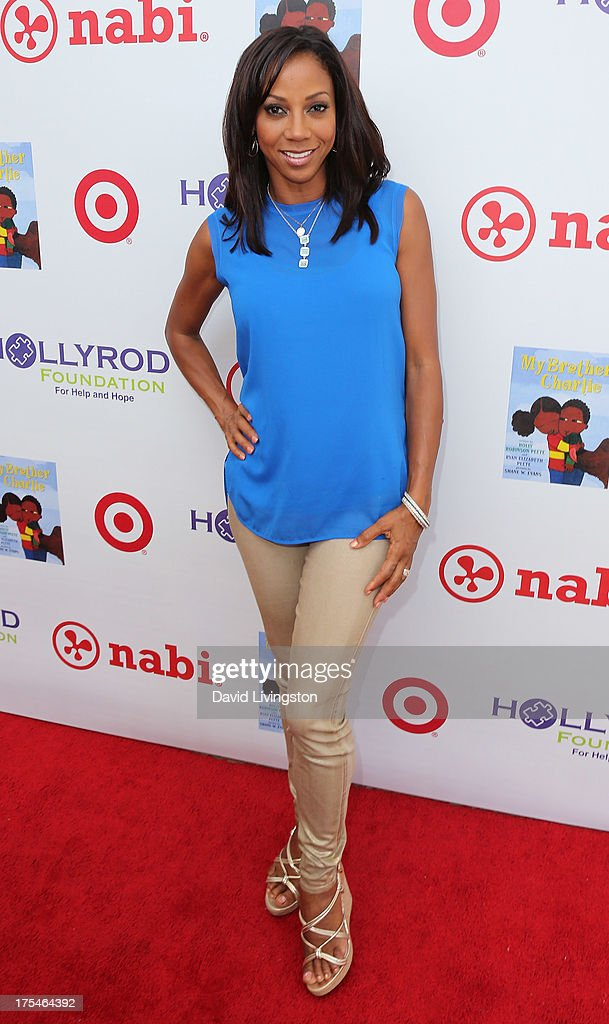 Actress <a gi-track='captionPersonalityLinkClicked' href=/galleries/search?phrase=Holly+Robinson+Peete&family=editorial&specificpeople=213716 ng-click='$event.stopPropagation()'>Holly Robinson Peete</a> attends the HollyRod Foundation's 4th Annual My Brother Charlie Carnival at Culver Studios on August 3, 2013 in Culver City, California.