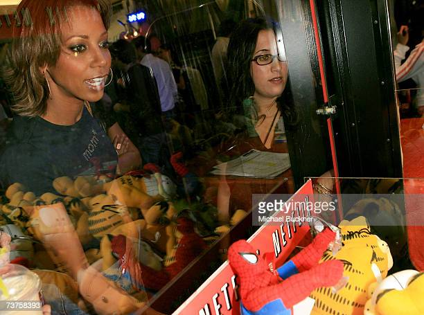 Actress Holly Robinson Peete plays with the Netflix claw machine in the Distinctive Assets gift lounge during the 20th annual Kid's Choice Awards at...