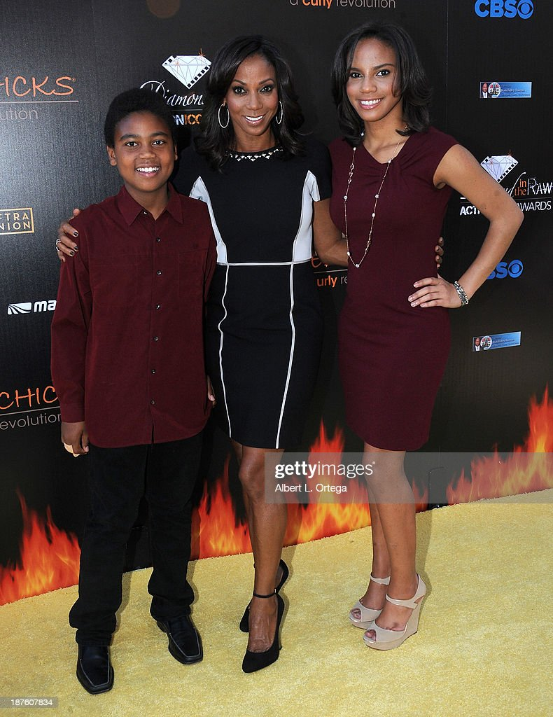 Actress Holly Robinson-Peete and children arrivefor the 6th Annual Diamond In The RAW -Action Icon Awards held at Skirball Cultural Center on November 10, 2013 in Los Angeles, California.