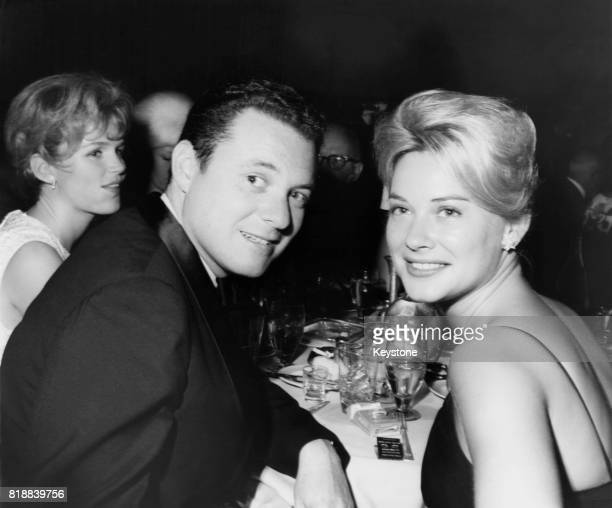 Actress Hope Lange and her partner director and producer Alan J Pakula at the Writers Guild of America 15th Annual Screen Awards dinner at the...