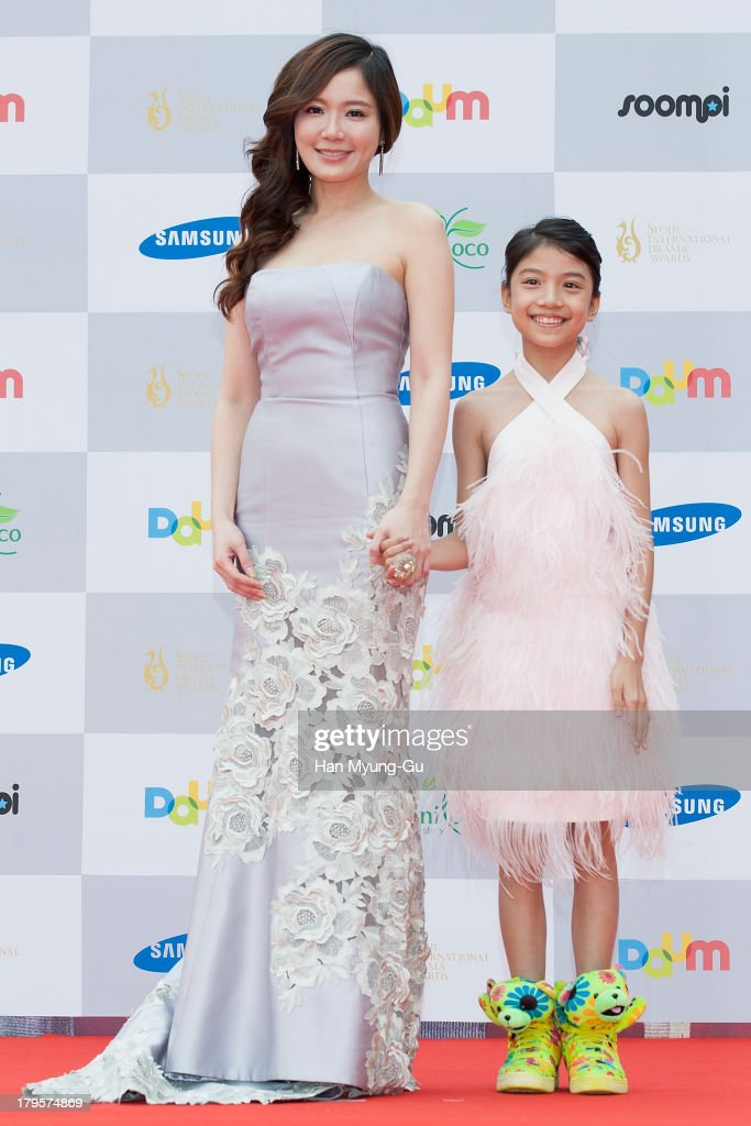 Actress Hsu Ya-Chi (R) from Taiwan arrives for photographs at the Seoul International Drama Awards 2013 at National Theater on September 5, 2013 in Seoul, South Korea.