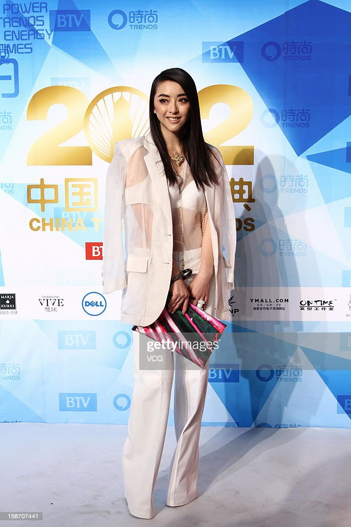 Actress Huang Xiaolei arrives at the red carpet of the 2012 China Trends Awards at BTV Grand Theater on December 22, 2012 in Beijing, China.