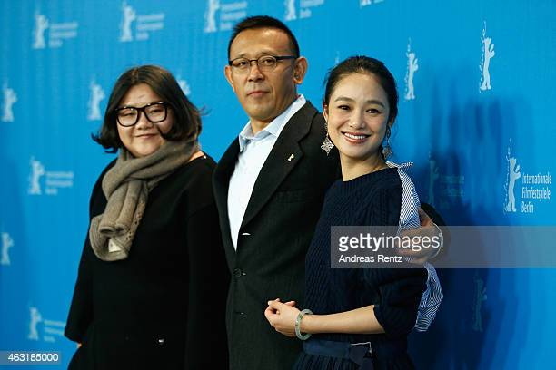 Actress Hung Huang director Jiang Wen and actress Zhou Yun attend the 'Gone with the Bullets' photocall during the 65th Berlinale International Film...