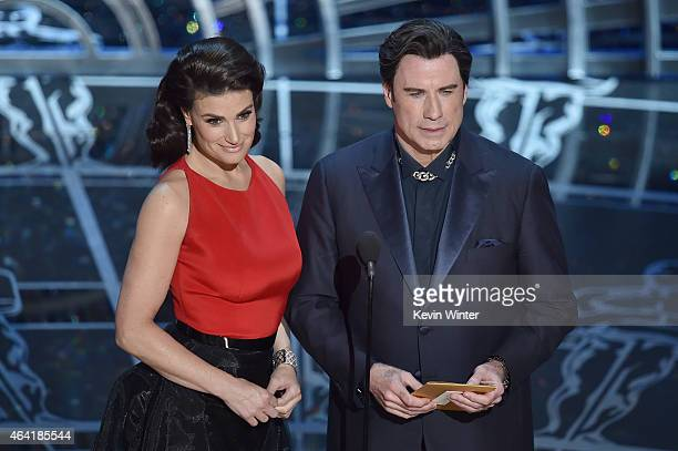 Actress Idina Menzel and actor John Travolta speak onstage during the 87th Annual Academy Awards at Dolby Theatre on February 22 2015 in Hollywood...