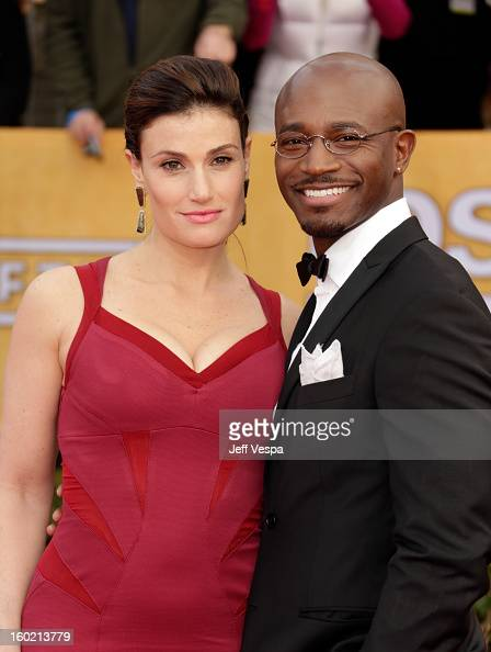 Actress Idina Menzel and actor Taye Diggs arrive at the 19th Annual Screen Actors Guild Awards held at The Shrine Auditorium on January 27 2013 in...