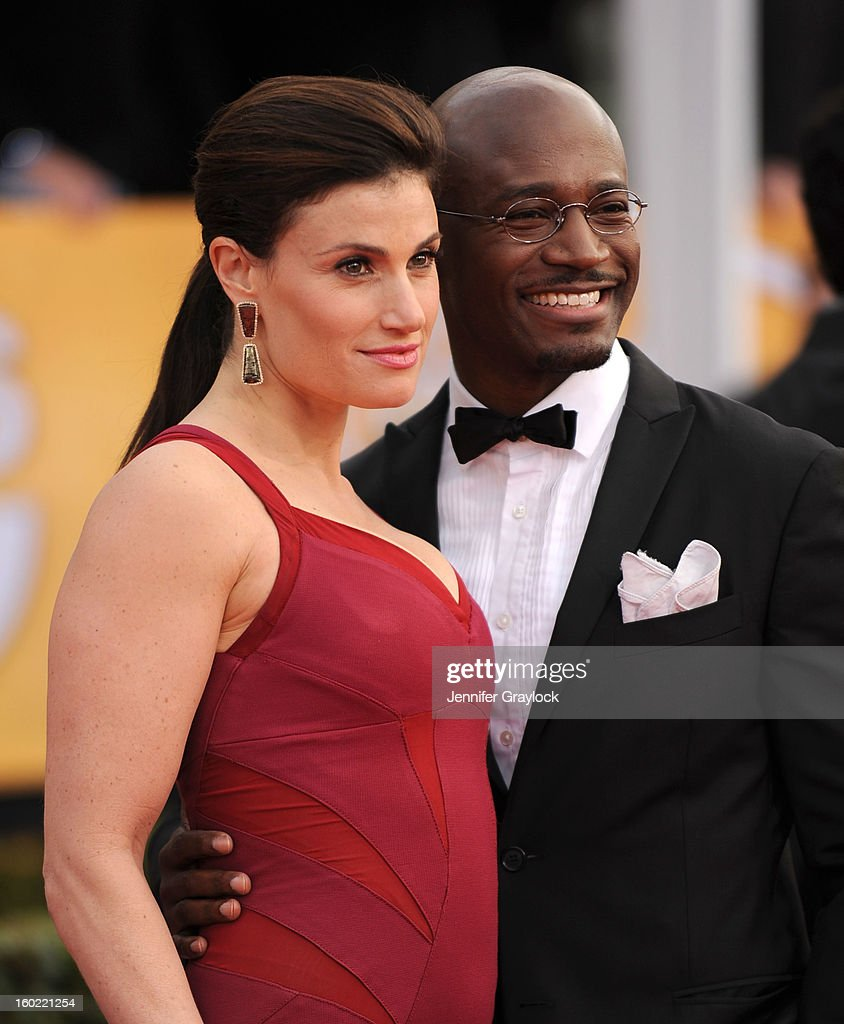 Actress Idina Menzel and her husband actor Taye Diggs arrive at the 19th Annual Screen Actors Guild Awards held at The Shrine Auditorium on January 27, 2013 in Los Angeles, California.