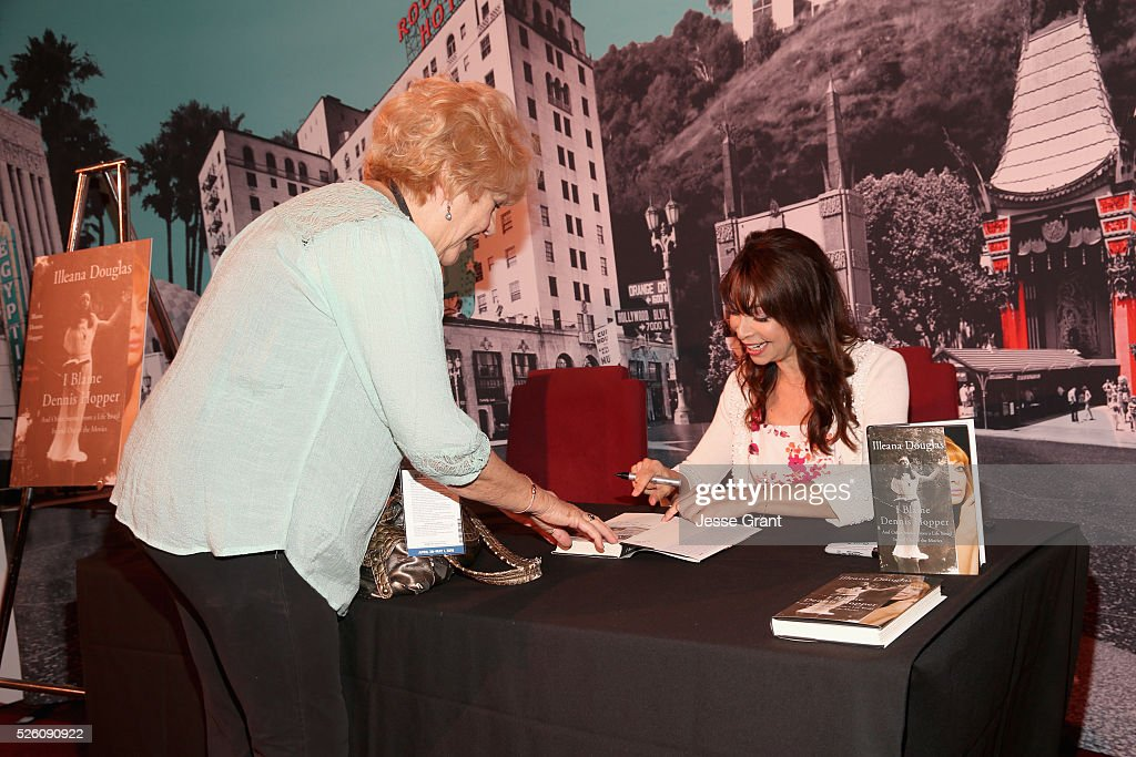 Actress <a gi-track='captionPersonalityLinkClicked' href=/galleries/search?phrase=Illeana+Douglas&family=editorial&specificpeople=208708 ng-click='$event.stopPropagation()'>Illeana Douglas</a> (R) and pass holder attend <a gi-track='captionPersonalityLinkClicked' href=/galleries/search?phrase=Illeana+Douglas&family=editorial&specificpeople=208708 ng-click='$event.stopPropagation()'>Illeana Douglas</a> book signing during day 2 of the TCM Classic Film Festival 2016 on April 29, 2016 in Los Angeles, California. 25826_009