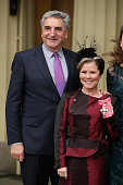 Actress Imelda Staunton poses with her husband Jim Carter after she received a CBE from the Prince William Duke of Cambridge for services to drama at...