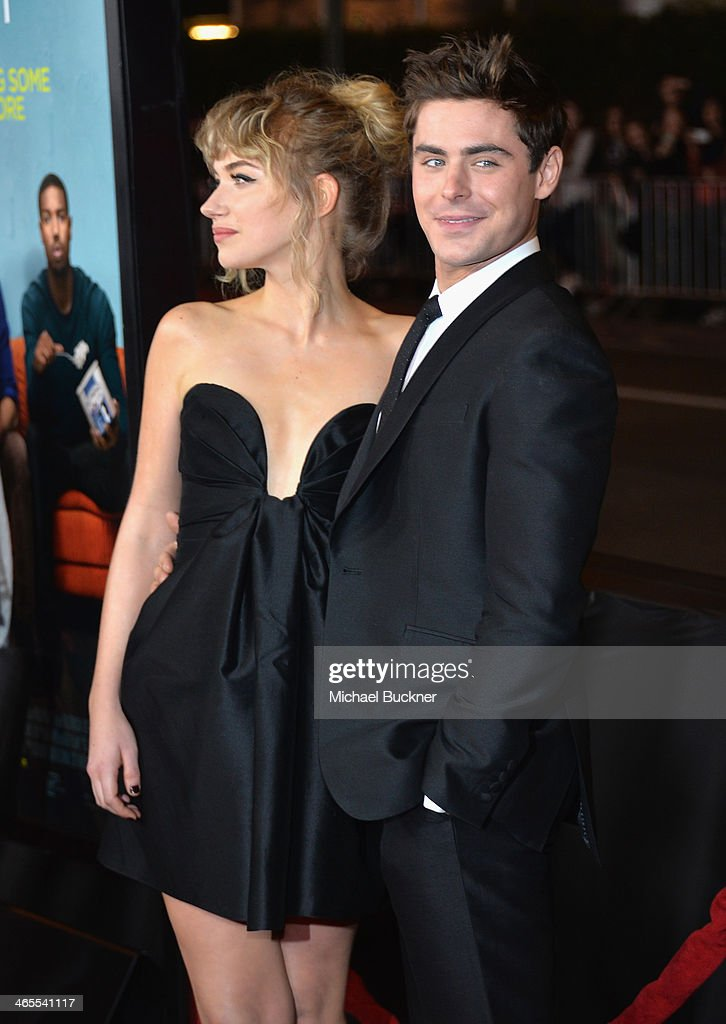 Actress Imogen Poots (L) and actor Zac Efron arrive at the premiere of Focus Features' 'That Awkward Moment' at Regal Cinemas L.A. Live on January 27, 2014 in Los Angeles, California.