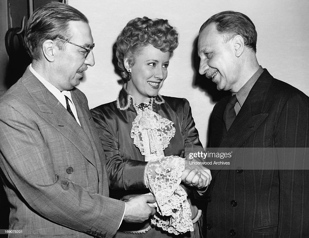 Actress Irene Dunne congratulates authors Howard Lindsey and Russel Crouse for receiving the Pulitzer Prize for their play 'State of the Union'...