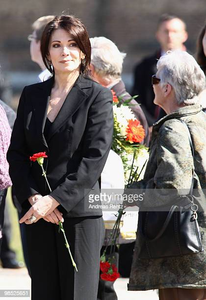 Actress Iris Berben holds flowers during an official commemoration ceremony during her visit to the former concentration camp Ravensbrueck on April...