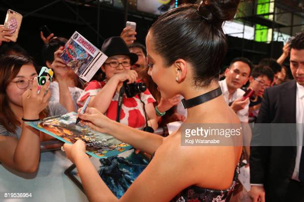 Actress Isabela Moner signs autograph for fans at the Japanese premiere of 'Transformers The Last Knight' at TOHO Cinemas Shinjuku on July 20 2017 in...
