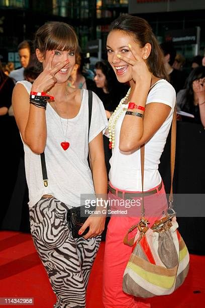 Actress Isabell Horn and actress Janina Uhse attend the 'Grand Opening Cinema Berlin' with the screening of 'Pirates Of The Caribbean On Stranger...