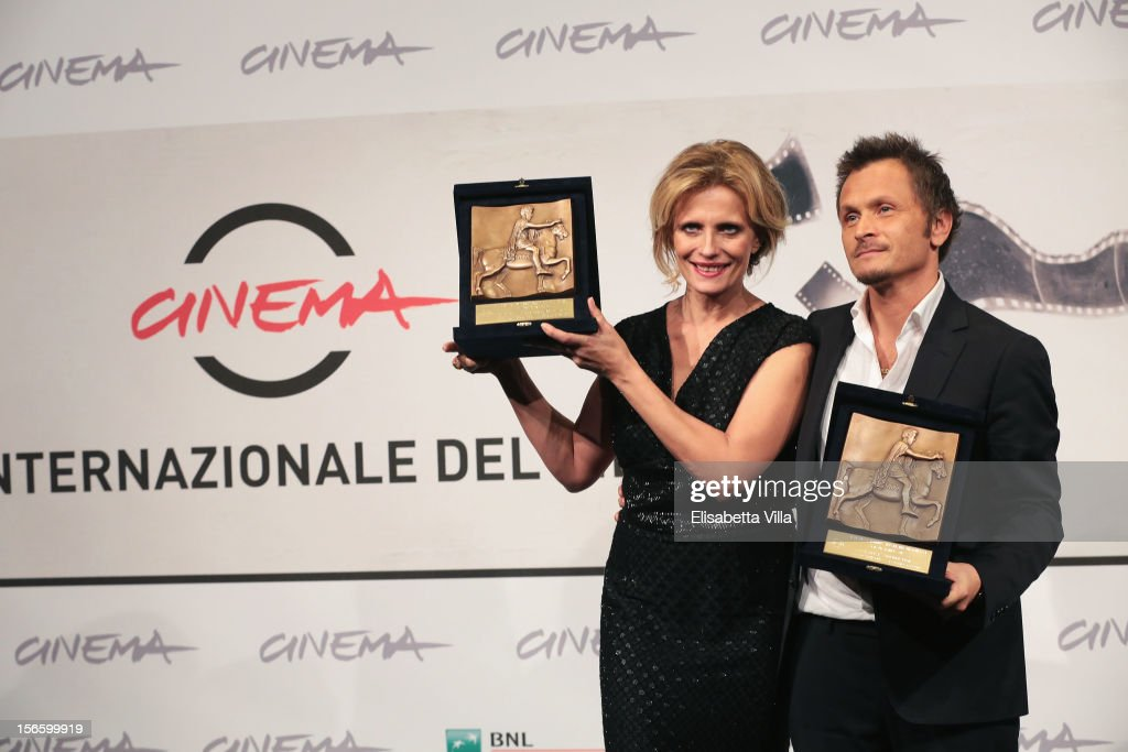 Actress <a gi-track='captionPersonalityLinkClicked' href=/galleries/search?phrase=Isabella+Ferrari&family=editorial&specificpeople=630378 ng-click='$event.stopPropagation()'>Isabella Ferrari</a> and director Paolo Franchi pose with her Best Actress Award and his Best Director Award during the Award Winners Photocall during the 7th Rome Film Festival at Auditorium Parco Della Musica on November 17, 2012 in Rome, Italy.