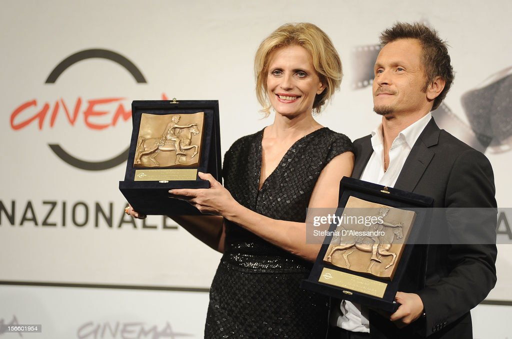 Actress <a gi-track='captionPersonalityLinkClicked' href=/galleries/search?phrase=Isabella+Ferrari&family=editorial&specificpeople=630378 ng-click='$event.stopPropagation()'>Isabella Ferrari</a> and director Paolo Franchi pose with her Best Actress Award and his Best Director Award during the Award Winners Photocall on November 17, 2012 in Rome, Italy.