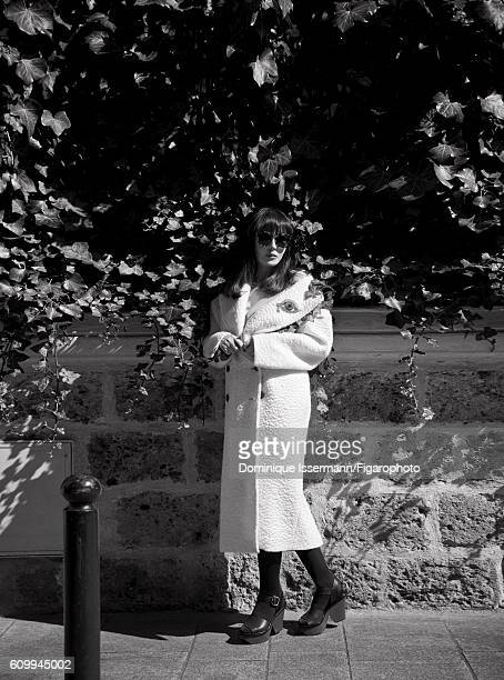 Actress Isabelle Adjani is photographed for Madame Figaro on April 4 2016 in Paris France Coat brooch tights sunglasses shoes CREDIT MUST READ...