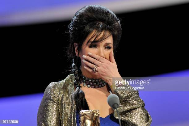 Actress Isabelle Adjani reacts onstage after she received Best Actress Cesar Award during 35th Cesar Film Awards at Theatre du Chatelet on February...