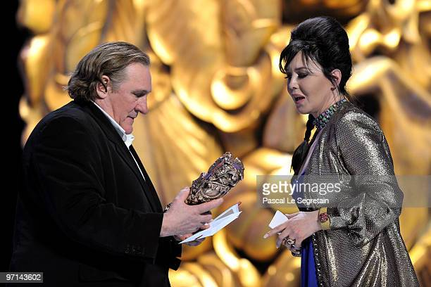 Actress Isabelle Adjani reacts onstage after she received Best Actress Cesar Award from Gerard Depardieu during 35th Cesar Film Awards at Theatre du...