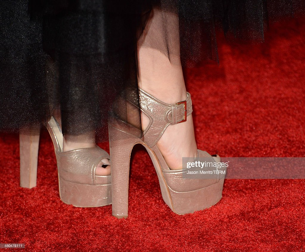 Actress Isabelle Fuhrman (shoe detail) arrives at the premiere of Lionsgate's 'The Hunger Games: Catching Fire' at Nokia Theatre L.A. Live on November 18, 2013 in Los Angeles, California.