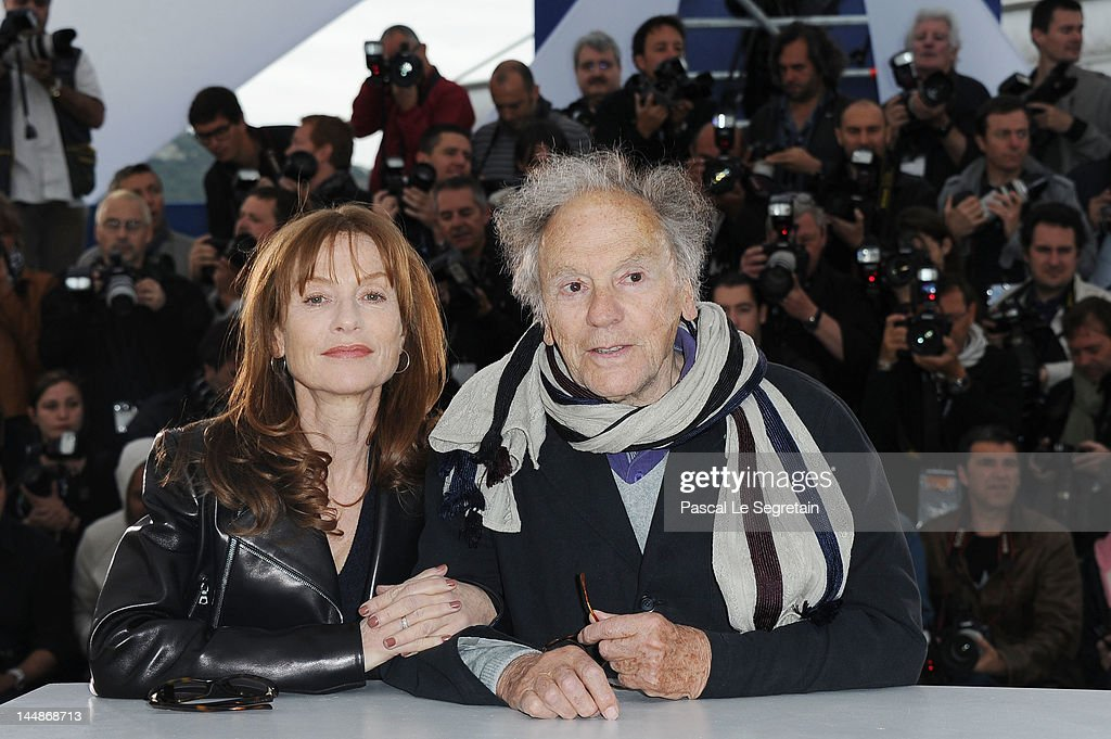 Actress <a gi-track='captionPersonalityLinkClicked' href=/galleries/search?phrase=Isabelle+Huppert&family=editorial&specificpeople=662796 ng-click='$event.stopPropagation()'>Isabelle Huppert</a> and actor <a gi-track='captionPersonalityLinkClicked' href=/galleries/search?phrase=Jean-Louis+Trintignant&family=editorial&specificpeople=1822183 ng-click='$event.stopPropagation()'>Jean-Louis Trintignant</a> pose at the 'Amour' Photocall during the 65th Annual Cannes Film Festival at Palais des Festivals on May 20, 2012 in Cannes, France.