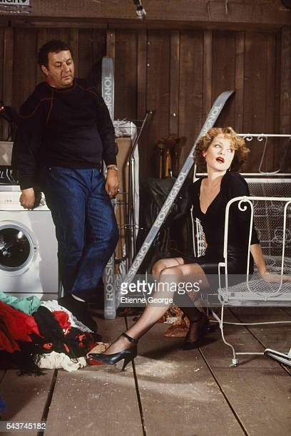 Actress Isabelle Huppert and comic Coluche on the set of the film 'La Femme de mon pote' directed by Bertrand Blier