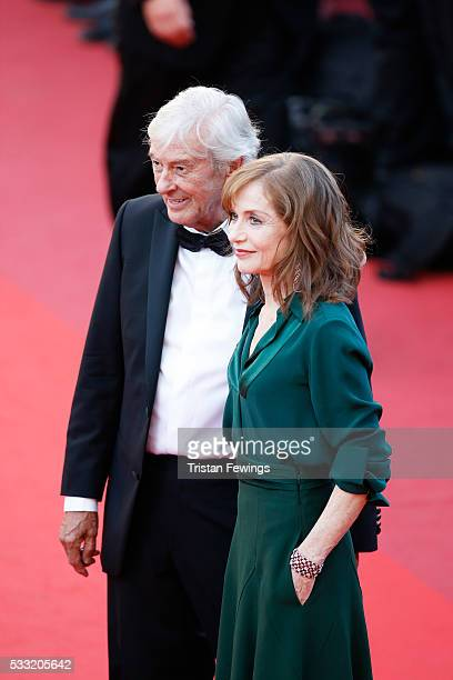 Actress Isabelle Huppert and director Paul Verhoeven attend the 'Elle' Premiere during the 69th annual Cannes Film Festival at the Palais des...