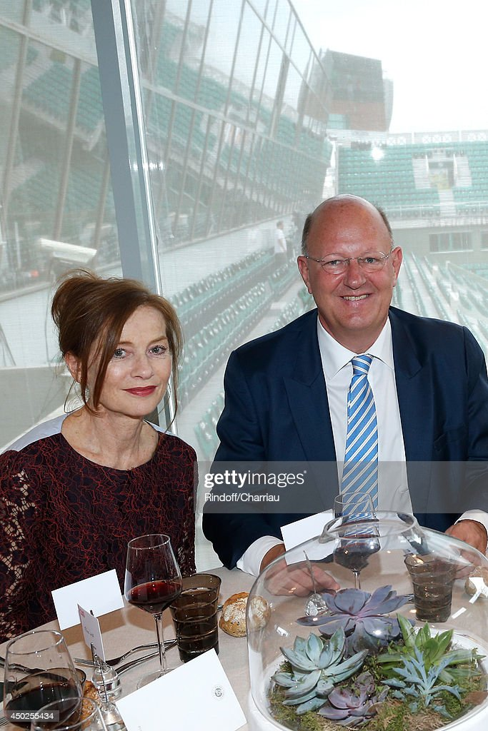 Actress Isabelle Huppert and President of France Television Remy Pflimlin pose at France Television french chanels studio after she won the Roland Garros French Tennis Open 2014 - Day 14 on June 7, 2014 in Paris, France.