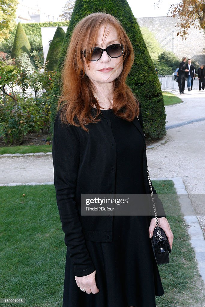 Actress <a gi-track='captionPersonalityLinkClicked' href=/galleries/search?phrase=Isabelle+Huppert&family=editorial&specificpeople=662796 ng-click='$event.stopPropagation()'>Isabelle Huppert</a> arriving at the Christian Dior show as part of the Paris Fashion Week Womenswear Spring/Summer 2014, held at Musee Rodin on September 27, 2013 in Paris, France.