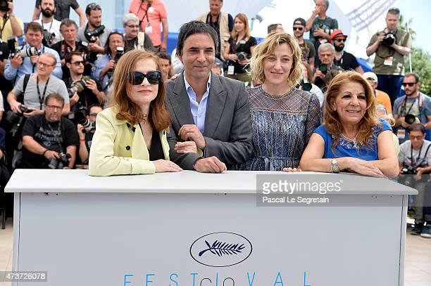 Actress Isabelle Huppert director Samuel Benchetrit actresses Valeria BruniTedeschi and Tassadit Mandi attend a photocall for 'Asphalte' during the...