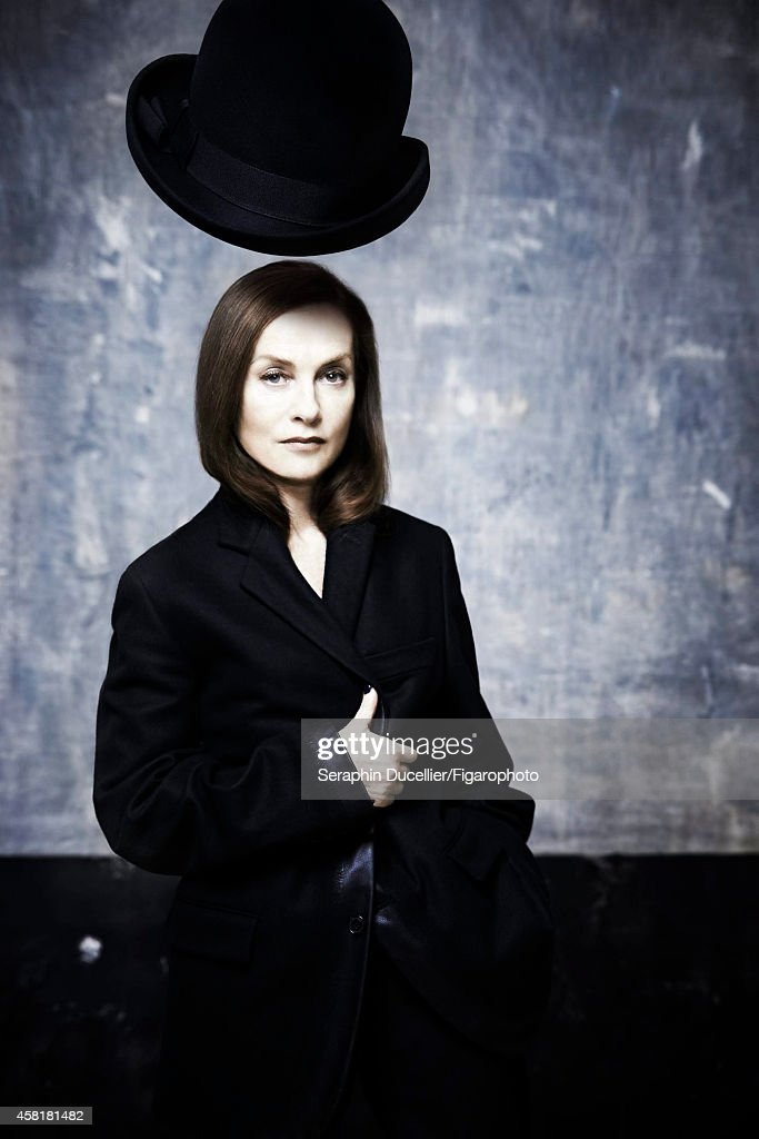Actress <a gi-track='captionPersonalityLinkClicked' href=/galleries/search?phrase=Isabelle+Huppert&family=editorial&specificpeople=662796 ng-click='$event.stopPropagation()'>Isabelle Huppert</a> is photographed for Madame Figaro on June 25, 2014 in Paris, France. Jacket and pants (Hermès), hat (Emporio Armani). COVER IMAGE.