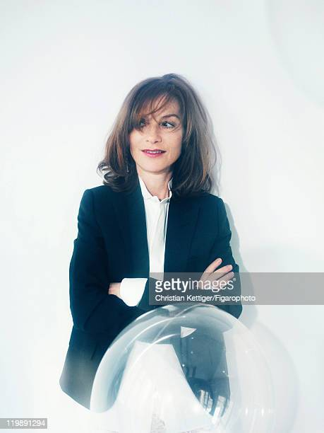 Actress Isabelle Huppert is photographed for Madame Figaro on March 8 2011 in Paris France Published image Figaro ID100078005 Suit jacket and shirt...