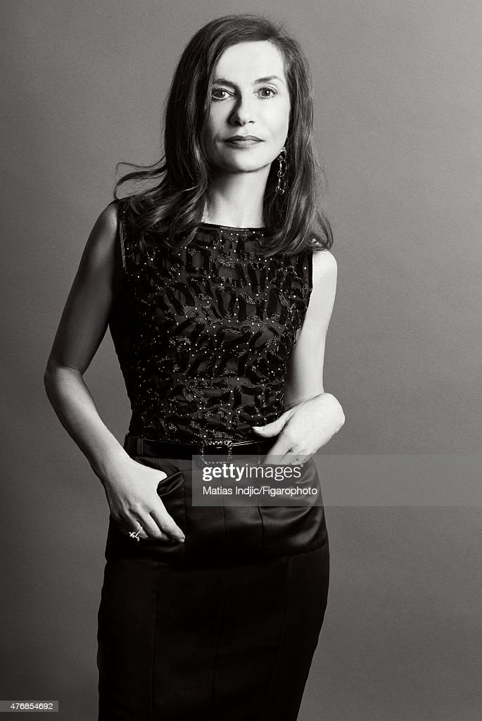 Actress <a gi-track='captionPersonalityLinkClicked' href=/galleries/search?phrase=Isabelle+Huppert&family=editorial&specificpeople=662796 ng-click='$event.stopPropagation()'>Isabelle Huppert</a> is photographed for Madame Figaro on May 17, 2015 at the Cannes Film Festival in Cannes, France. Top and skirt (Chanel Haute Couture), earrings and ring (Chopard). Make-up by Chanel. PUBLISHED IMAGE.