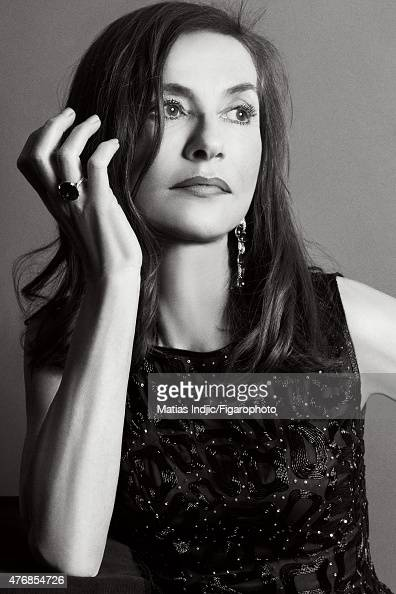 Actress Isabelle Huppert is photographed for Madame Figaro on May 17 2015 at the Cannes Film Festival in Cannes France Top and skirt earrings and...