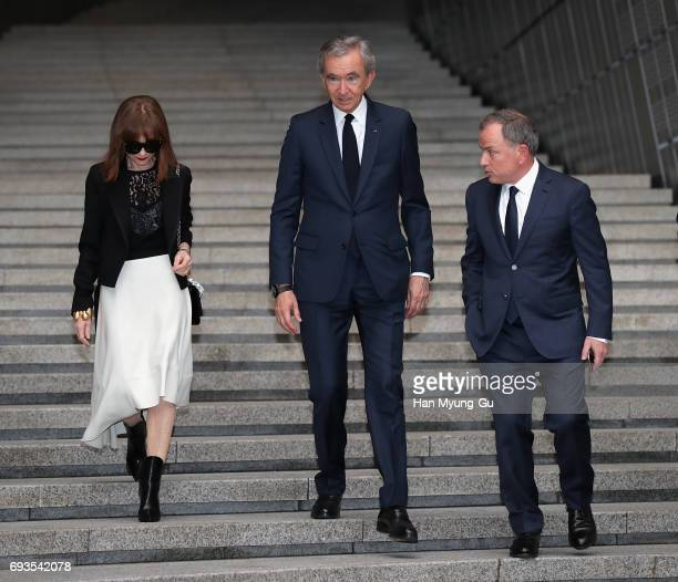 Actress Isabelle Huppert LVMH Chairman and CEO Bernard Arnault and Chairman and Louis Vuitton Chairman CEO Michael Burke attend the photocall for...
