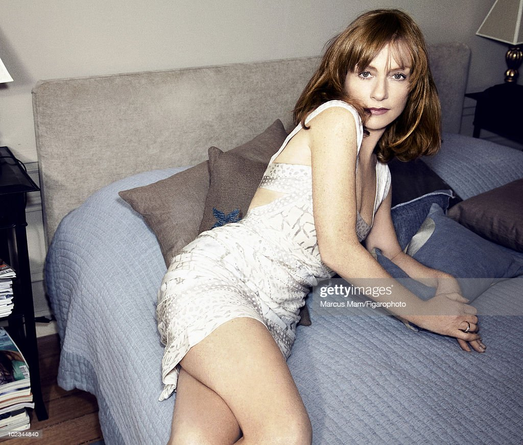 Actress <a gi-track='captionPersonalityLinkClicked' href=/galleries/search?phrase=Isabelle+Huppert&family=editorial&specificpeople=662796 ng-click='$event.stopPropagation()'>Isabelle Huppert</a> poses at a portrait session for Madame Figaro Magazine in Paris, February 2010. Dress by Herve Leger. Ring by Cartier. Published image. Image ID 096120-002.