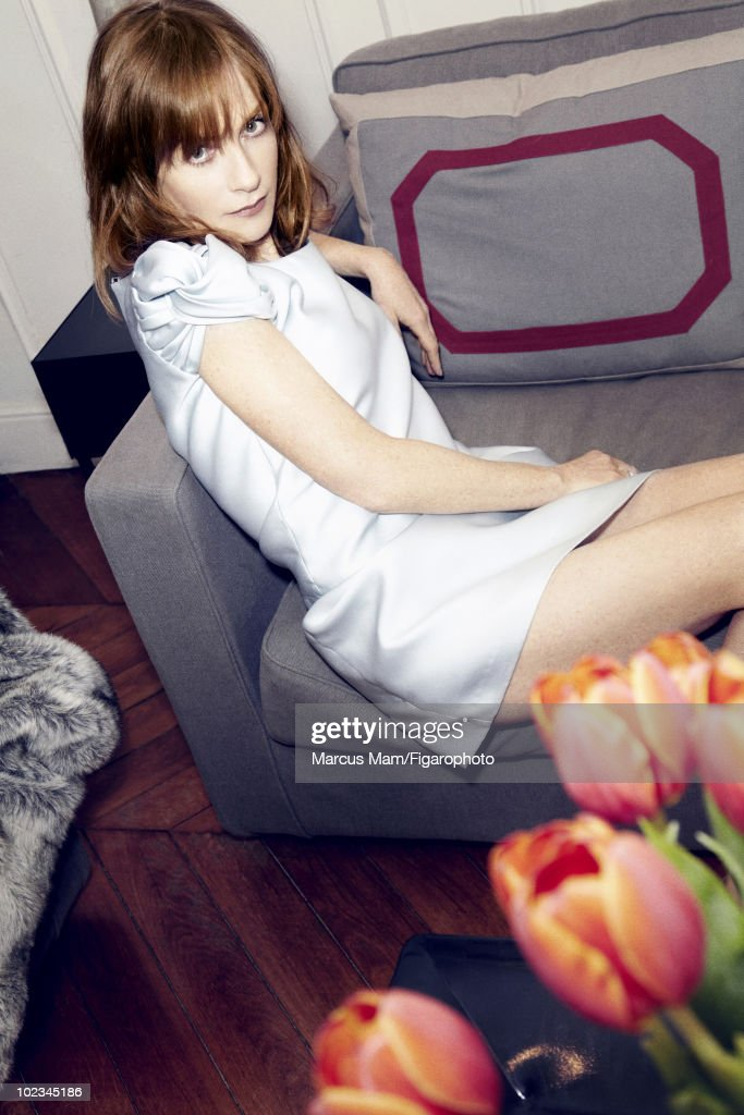 Actress <a gi-track='captionPersonalityLinkClicked' href=/galleries/search?phrase=Isabelle+Huppert&family=editorial&specificpeople=662796 ng-click='$event.stopPropagation()'>Isabelle Huppert</a> poses at a portrait session for Madame Figaro Magazine in Paris, February 2010. Dress by Burberry. Ring by Christopher Bailey. Published image. Image ID 096120-003.