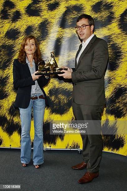 Actress Isabelle Huppert poses with Olivier Pere and the Moet Chandon Excellent Award during the 64th Festival del Film di Locarno on August 7 2011...
