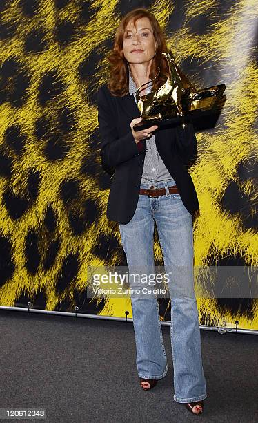 Actress Isabelle Huppert poses with the Moet Chandon Excellent Award during the 64th Festival del Film di Locarno on August 7 2011 in Locarno...