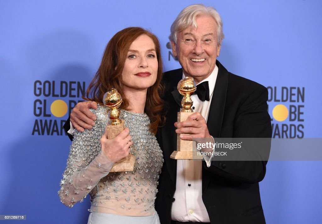 TOPSHOT - Actress Isabelle Huppert, winner of Best Actress in a Motion Picture - Drama for 'Elle,' and director Paul Verhoeven, winner of Best Foreign Language Film for 'Elle,' pose in the press room at the 74th Annual Golden Globe Awards at The Beverly Hilton Hotel on January 8, 2017 in Beverly Hills, California. / AFP / ROBYN