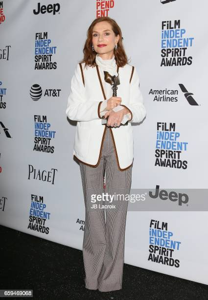 Actress Isabelle Huppert winner of the Best Female Lead award for 'Elle' poses in the press room during the 2017 Film Independent Spirit Awards on...