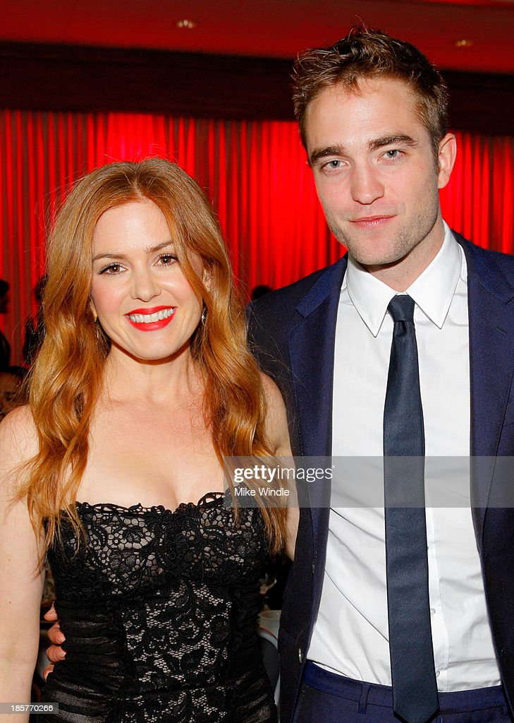 Actress Isla Fisher (L) and actor Robert Pattinson attend the 2nd Annual Australians in Film Awards Gala at Intercontinental Hotel on October 24, 2013 in Beverly Hills, California.